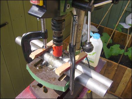 DIY drill press jig for drill half circles in aluminum pipe